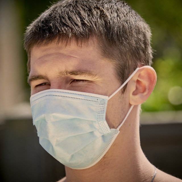 """Man wearing a protective medical mask"" stock image"