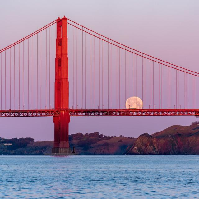 """""""Golden Gate Bridge sunrise and moonset"""" stock image"""