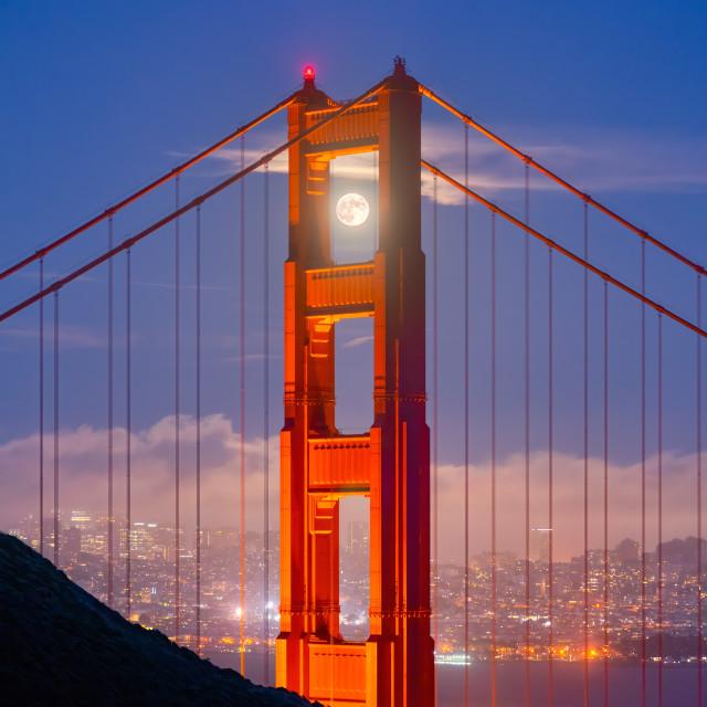 """Moon framed by the Golden Gate Bridge"" stock image"