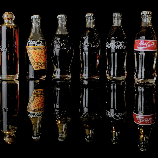 """Coke Bottle Evolution Miniatures"" stock image"