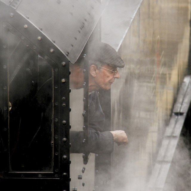 """""""Steam Train Driver visible through the Steam"""" stock image"""