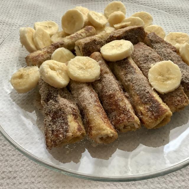 """Cinnamon bread sticks and bananas"" stock image"