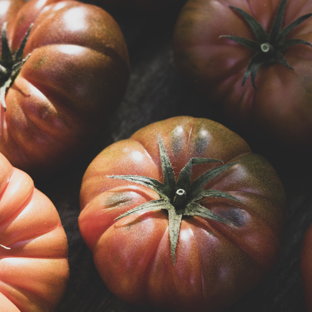 """Top front view of a group of red tomatoes produced in an organic"" stock image"