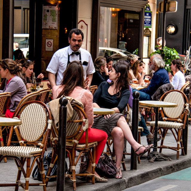 """""""Waiter taking the order at a Pavement Cafe in Paris"""" stock image"""