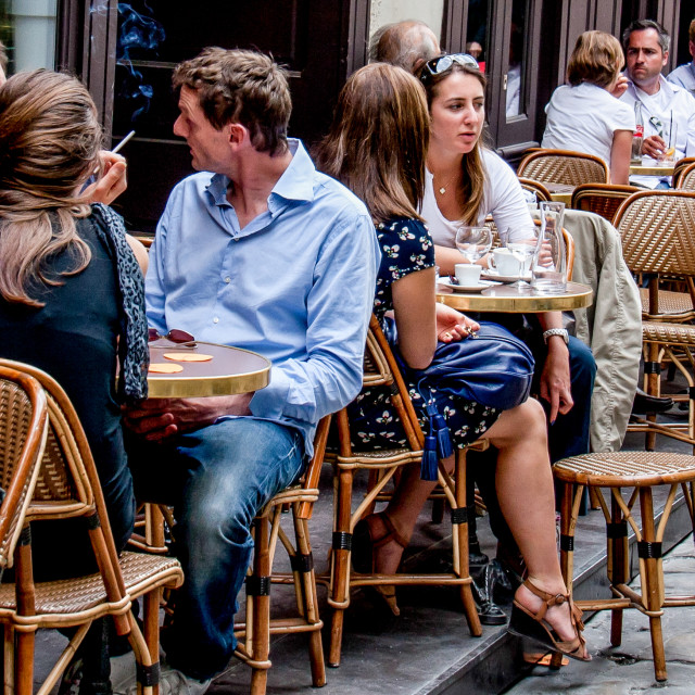 """Chatting at a Pavement Cafe in Paris"" stock image"