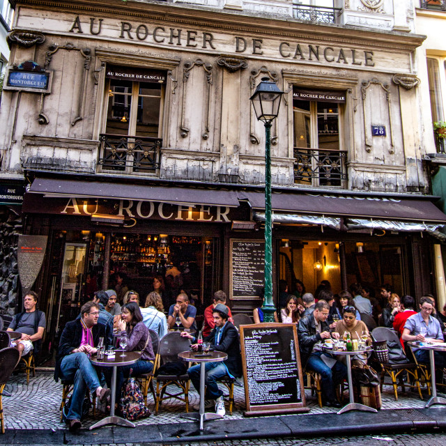 """Vibrant, Busy Pavement Cafe in Paris"" stock image"