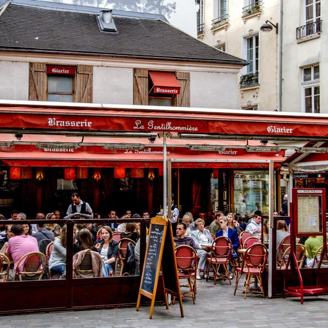 """Vibrant Pavement Cafe in Paris"" stock image"