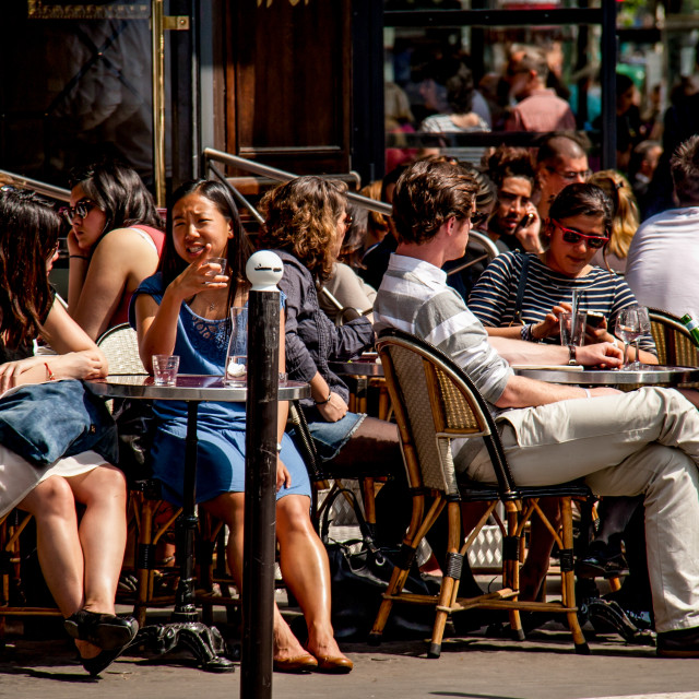 """Discussions in Pavement Cafe in Paris"" stock image"