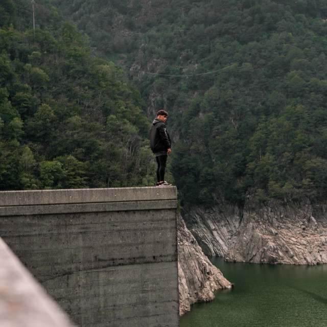 """standing on a Dam"" stock image"