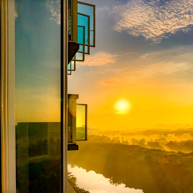 """Windows and Sunrise Reflections"" stock image"