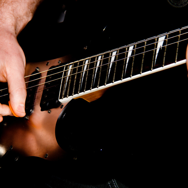"""""""Playing Electric Guitar."""" stock image"""