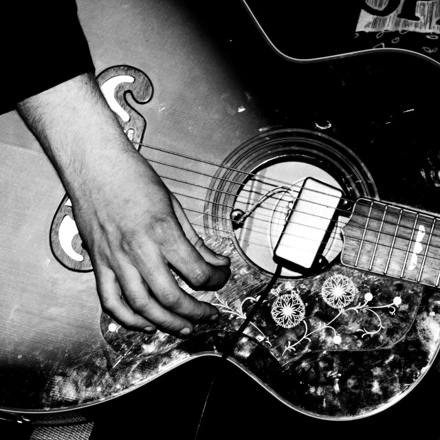 """""""Guitar Playing, acoustic with pickup."""" stock image"""