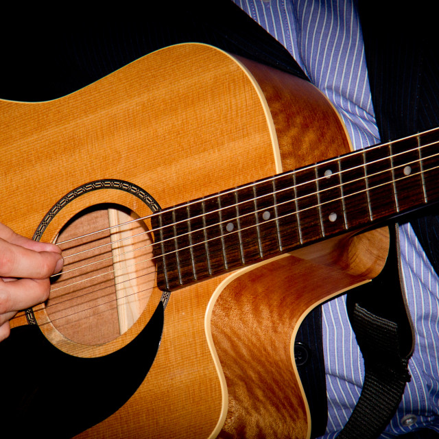 """""""Playing Acoustic Guitar."""" stock image"""