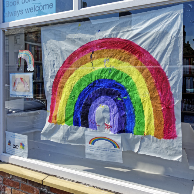 """""""A Rainbow of Hope picture in the window of a bookshop"""" stock image"""