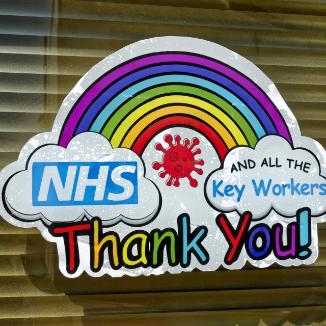 """""""A Thank You NHS & Key Workers Rainbow of Hope Sign on a window"""" stock image"""