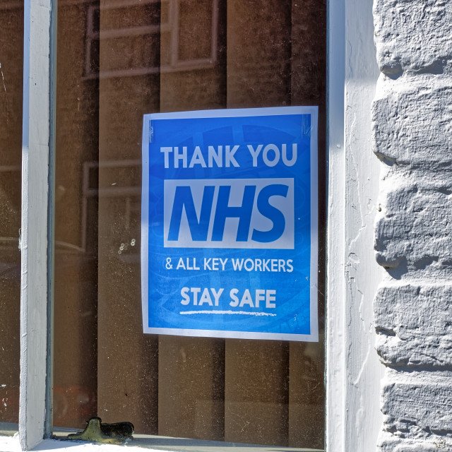 """""""A Thank You NHS & All Key Workers Sign in a house window"""" stock image"""