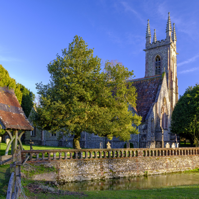 """Evening light on St Nicholas' church and Chawton House, in the S"" stock image"