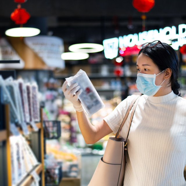 """""""Asian woman shopping for groceries in the market wearing mask an"""" stock image"""