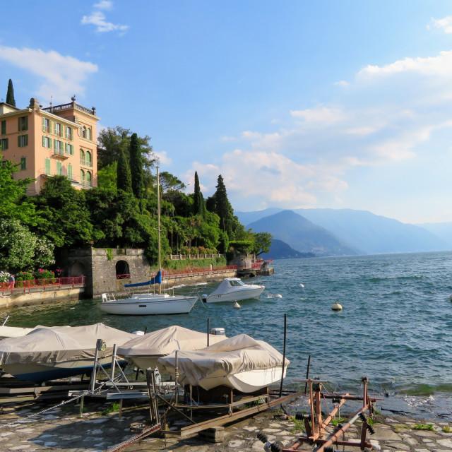 """Lakeside Villa and Boats"" stock image"