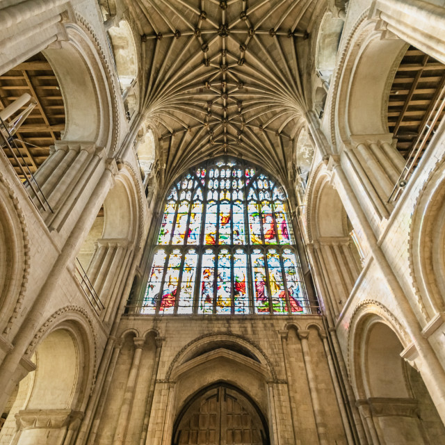 """Cathedral interior with stained glass window"" stock image"