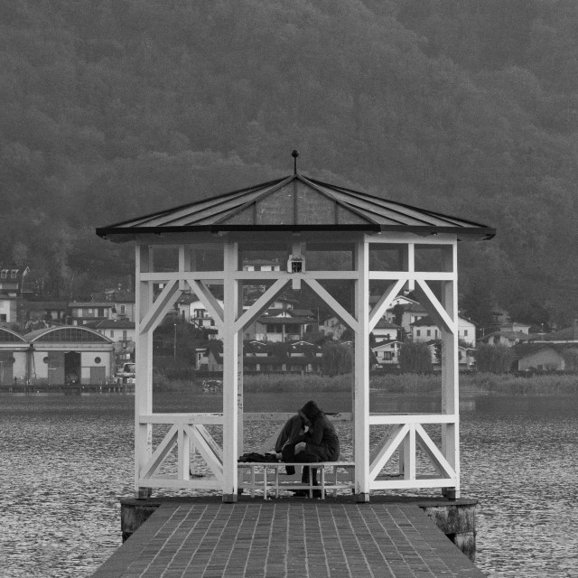 """""""pair of lovers under a gazebo on the pier of a lake"""" stock image"""