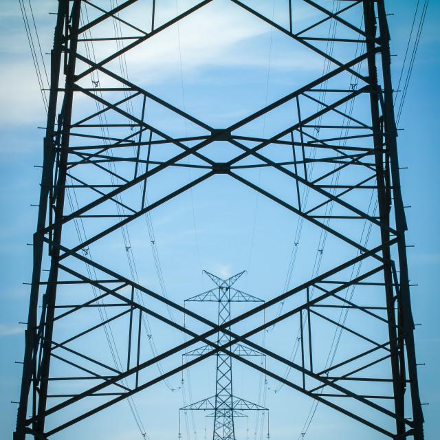 """""""High voltage transmission line against blue sky"""" stock image"""