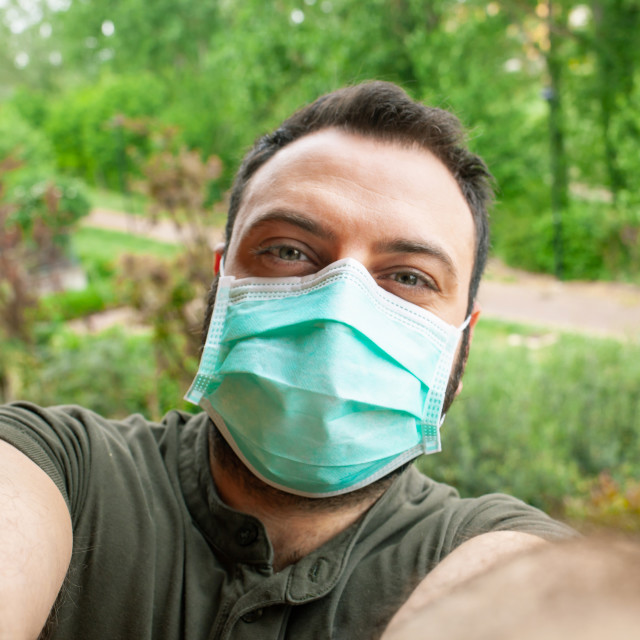 """Young Man making a selfie with surgical mask during the quarantine period..."" stock image"