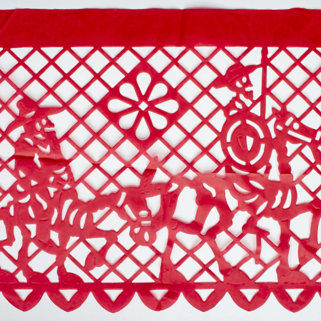 """Day of the Dead, Papel Picado. Red Real traditional Mexican paper cutting flag. Isolated on white background."" stock image"