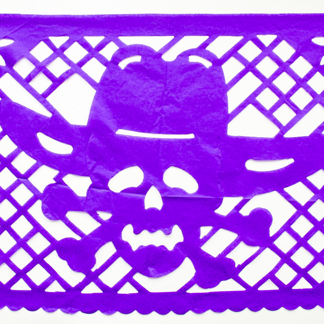 """Day of the Dead, Papel Picado. Purple Real traditional Mexican paper cutting flag. Isolated on white background."" stock image"