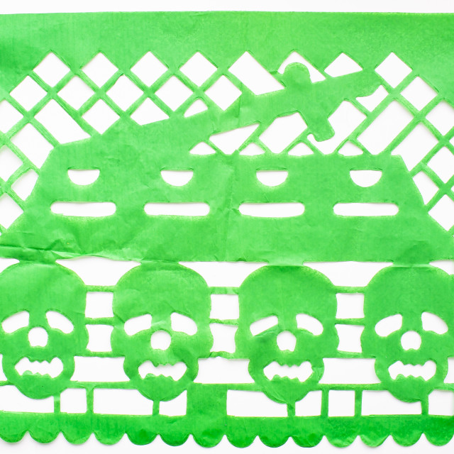 """Day of the Dead, Papel Picado. Green Real traditional Mexican paper cutting flag. Isolated on white background."" stock image"