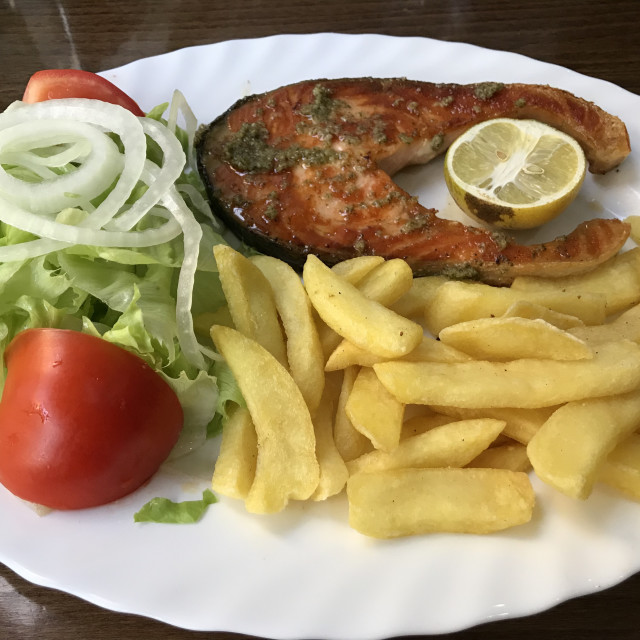"""Salmon steak with fries and salad"" stock image"