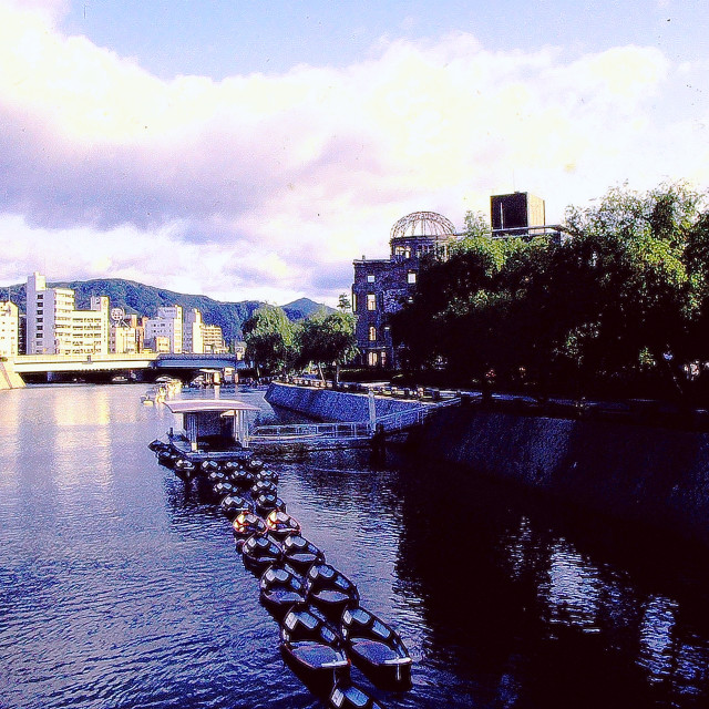 """A string of small pleasure paddle boats anchored on Hiroshima's Motoyas River"" stock image"
