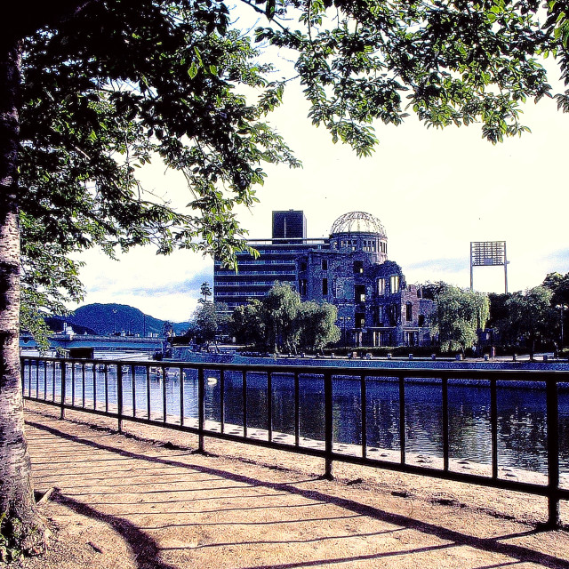 """Hiroshima's Motoyasu River, with the Atomic Dome, which was Ground Zero for the Atomic Bombing of the city"" stock image"