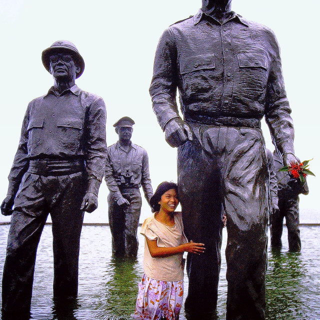 """Little Filipino girl at the General MacArthur Memorial in Leyte Island, Philippines"" stock image"
