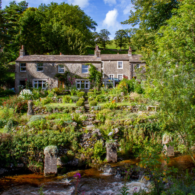 """""""Picturesque Cottages next to Kettlewell Beck in Kettlewell."""" stock image"""