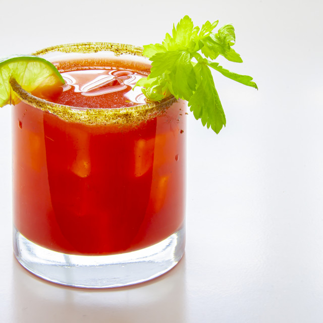 """Close up of a cold caesar cocktail or bloody mary on a glass on a white background"" stock image"