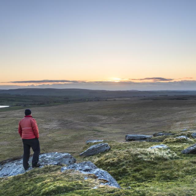 """A Walker Enjoying the View over Baldersdale just before Sunrise"" stock image"