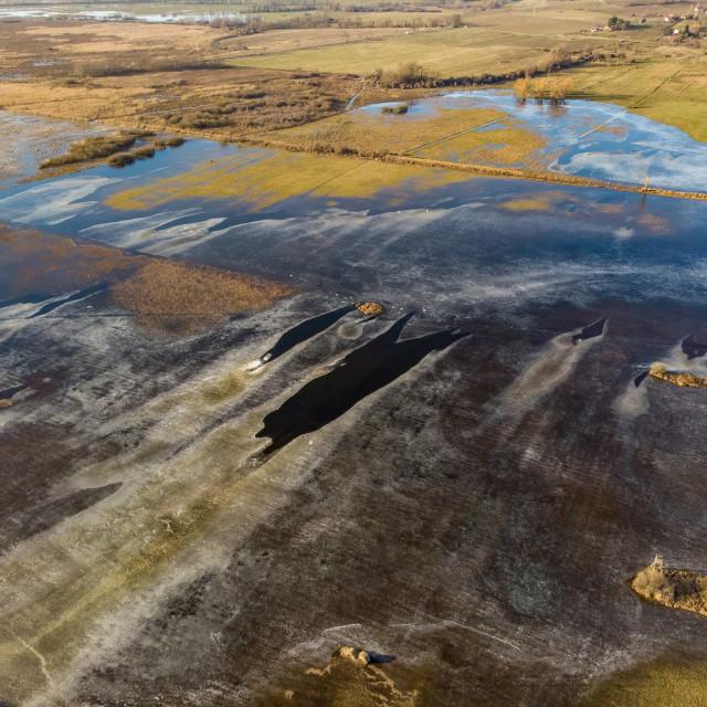 """Aerial winter landscape over frozen pond"" stock image"