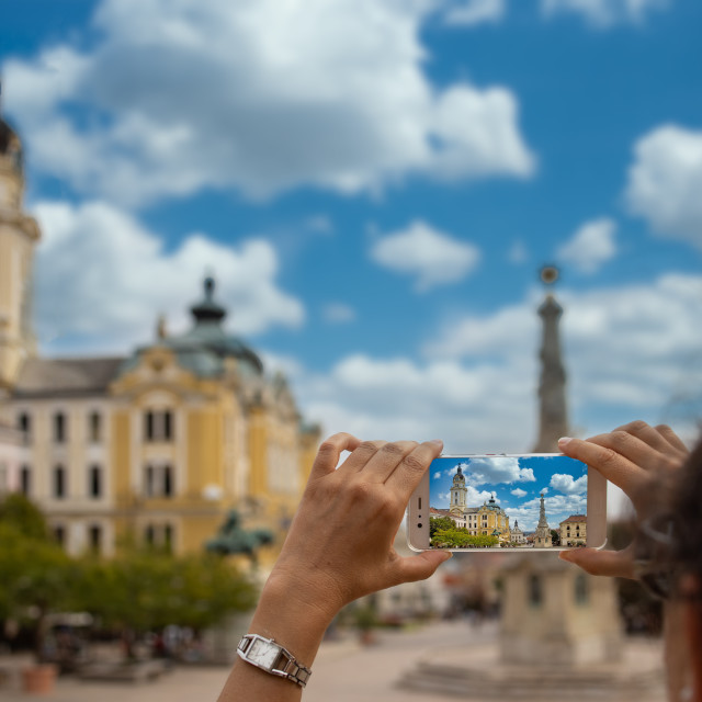 """""""Woman take a picture with mobile phone from a Hungarian town Pecs"""" stock image"""