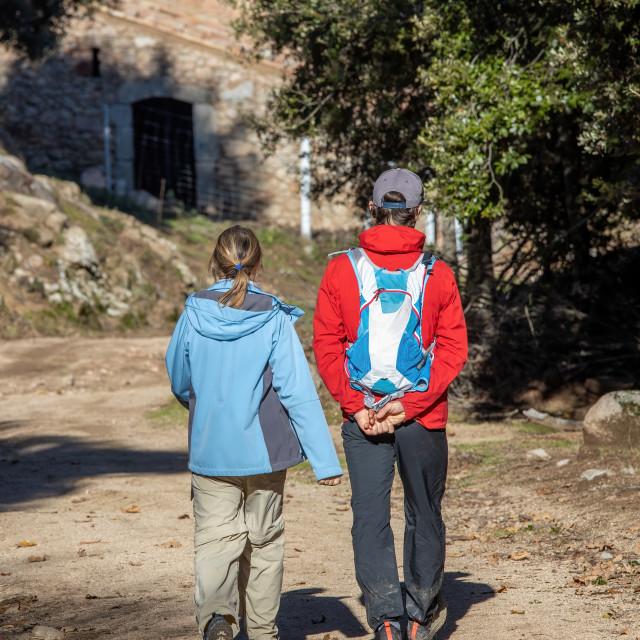 """Young couple tourists trekking on the Spanish mountain Montseny"" stock image"