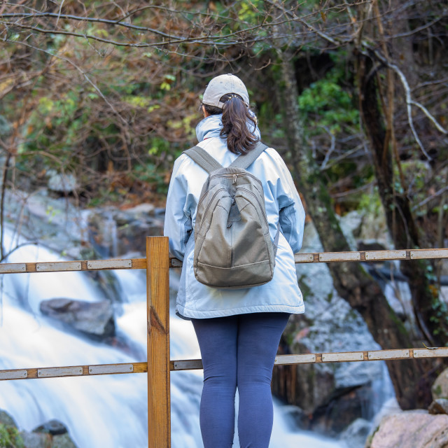 """""""Spanish tourist woman looking a small river in the Spanish mountain Montseny"""" stock image"""