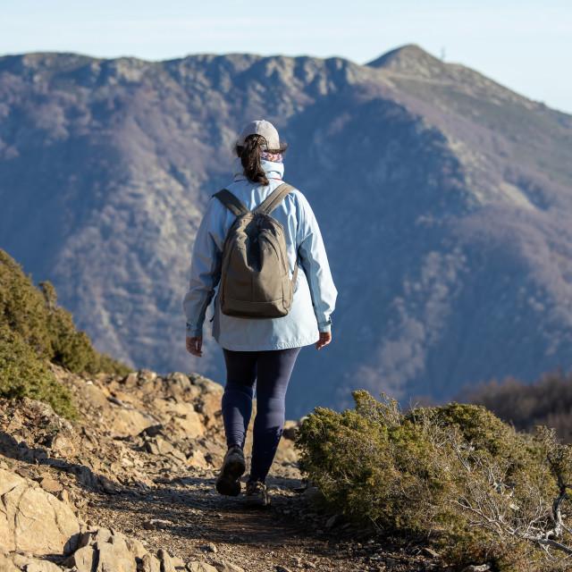 """Spanish tourist woman walking in the Spanish mountain Montseny"" stock image"