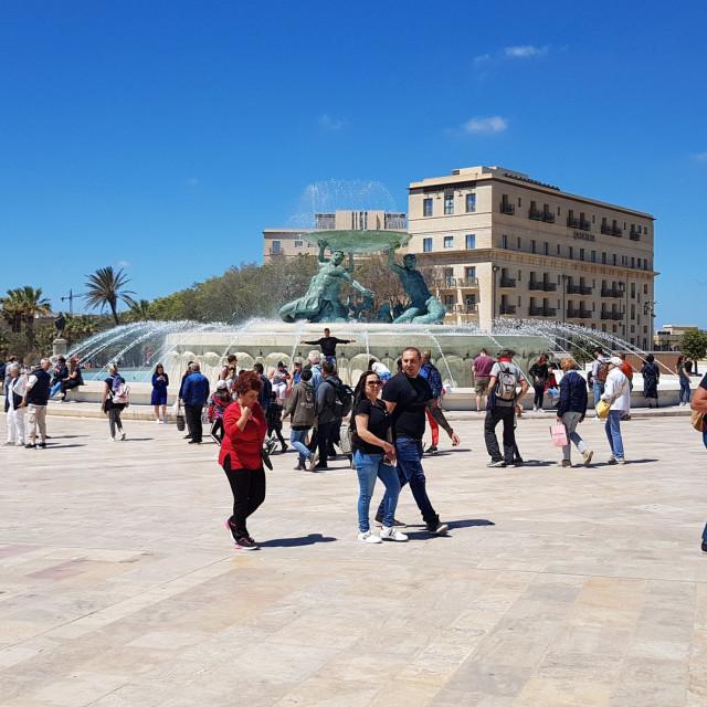 """""""Triton Founatin and Tourists in Valletta, Malta"""" stock image"""