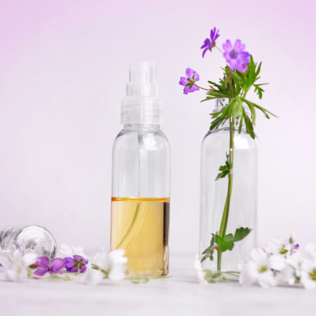 """""""front view of essential oil and freshness flowers in bottle on"""" stock image"""