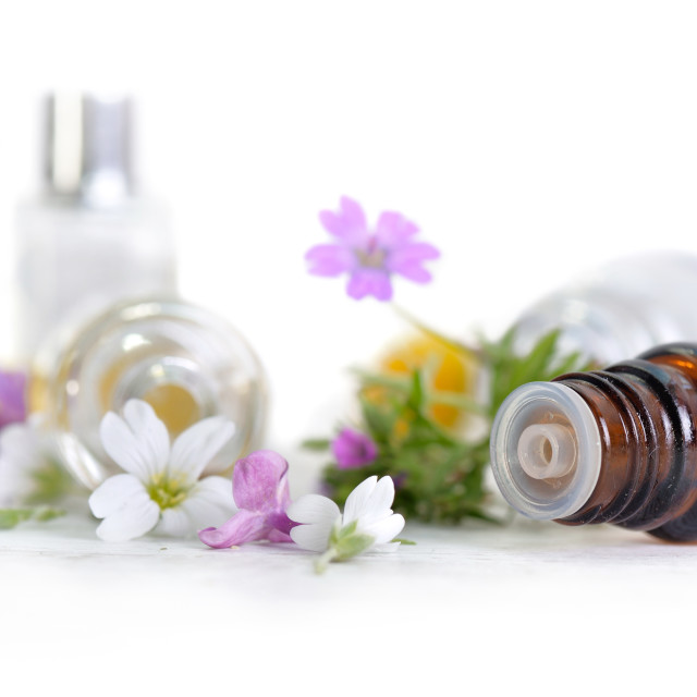 """""""close on bottle of essential oil spilled and white end pink pet"""" stock image"""