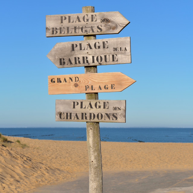 """""""wooden panel in the sand indicating in french : beluga beach,"""" stock image"""