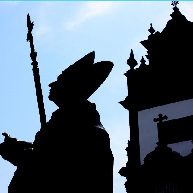 """""""Braga, Portugal - Silhouette of a statue of Dom Frei Bartolomeu Dos Martires Archbishop of Braga"""" stock image"""