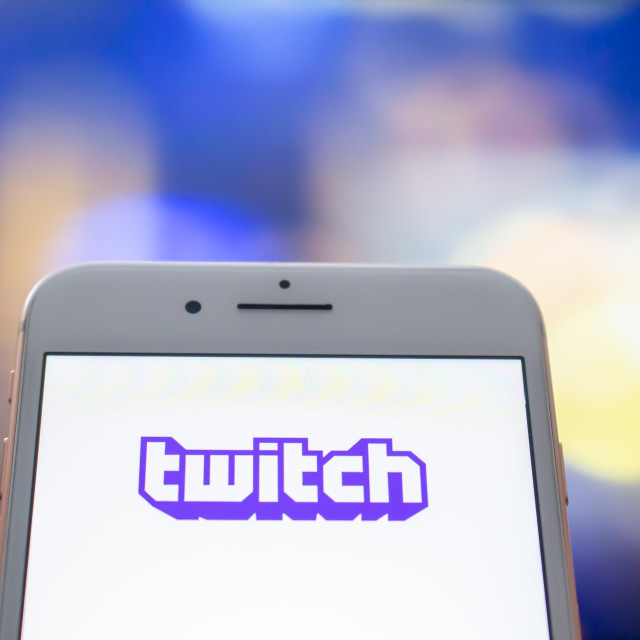 """""""Calgary, Alberta. Canada May 22, 2020. An iPhone Plus with a Twitch logo on the screen."""" stock image"""