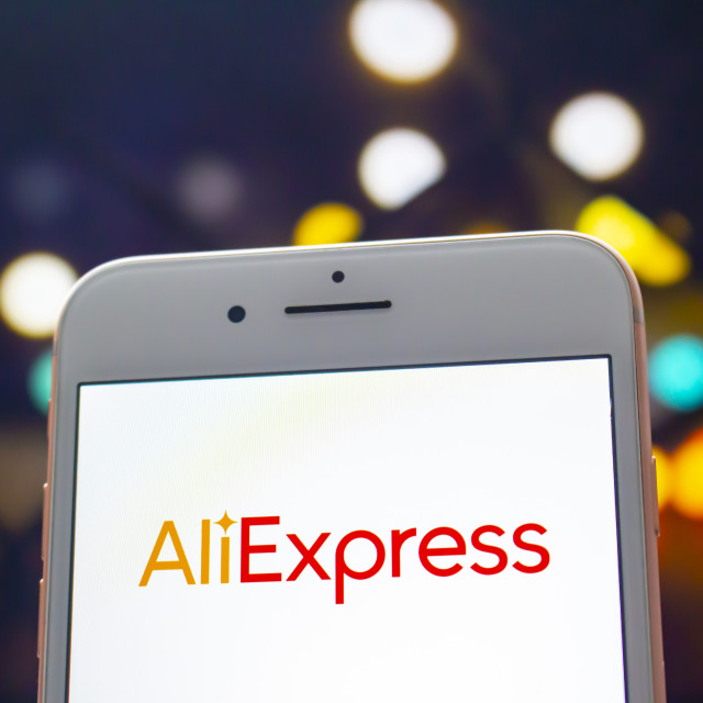 """Calgary, Alberta. Canada May 22, 2020. An iPhone Plus with a AliExpress logo on the screen."" stock image"