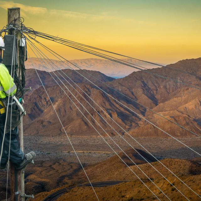 """Engineer Repairing A Desert Telephone Line"" stock image"